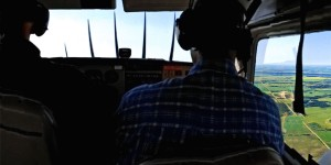 Conservation programs specialist Mark Francis rides shotgun on a Ducks Unlimited Canada compliance flight, observing the state of DUC land purchases and conservation easements.
