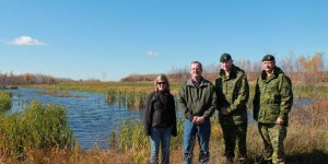 (Left to right) Base Gagetown range biologist Deanna McCullum, Joe Harvey, Colonel Craig Dalton, Commander and Chief Warrant Officer Claude Chouinard, Sergeant Major at one of the restored wetlands on the base.