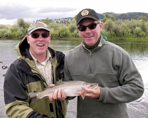 Former DUC president Jack H. Hole (left) and former federal environment minister Jim Prentice pose with a trout caught from the Missouri River. ©Barry Turner