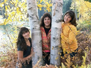 Susi Johanson (center), with daughters Dania (left) and Morgan.  Johanson encourages her kids to explore the outdoor world around them. ©DUC