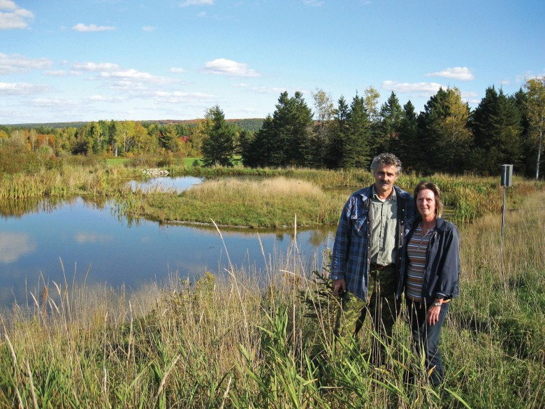Alain Champagne and his wife Lorraine, in front of their wetland in Saint-Victor-de-Beauce.